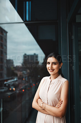 Buy stock photo Portrait of a young businesswoman standing on the office balcony