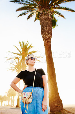 Buy stock photo Cropped shot of an attractive young woman spending the day on the promenade