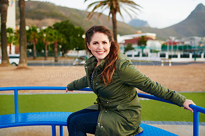 Buy stock photo Cropped shot of a beautiful young woman having fun in a playground outside