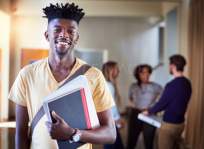 Buy stock photo Portrait of a university student standing in a corridor at campus