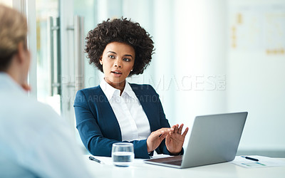Buy stock photo Shot of a businesswoman using her laptop while meeting with a client