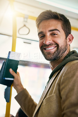 Buy stock photo Cropped portrait of a handsome young man on his morning bus commute