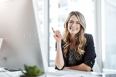 Buy stock photo Portrait of a young businesswoman gesturing with her hand at her desk in a modern office