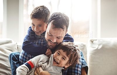 Buy stock photo Portrait of two adorable little boys having fun with their father at home