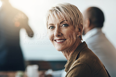 Buy stock photo Cropped portrait of a mature businesswoman sitting in the boardroom during a presentation