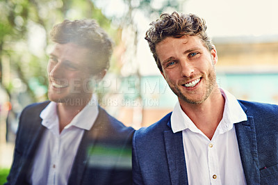 Buy stock photo Portrait of a handsome young businessman outside
