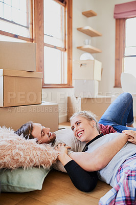 Buy stock photo Cropped shot of a happy young couple being affectionate in their new home