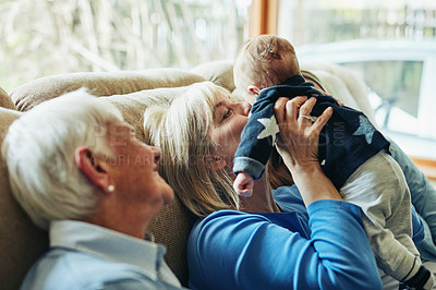 Buy stock photo Shot of a family bonding with a little baby at home
