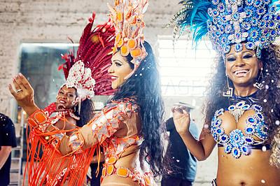 Buy stock photo Shot of beautiful samba dancers performing at a carnival