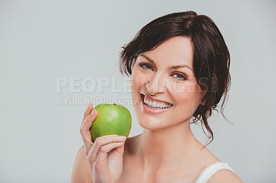 Buy stock photo Cropped shot of a beautiful woman holding an apple