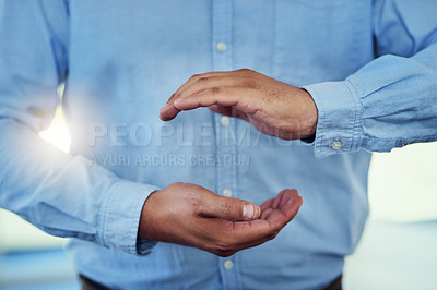 Buy stock photo Cropped shot of a businessman making a gesture with cupped hands