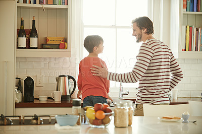 Buy stock photo Cropped shot of a father and his little son cleaning dishes together at home
