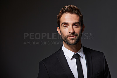 Buy stock photo Cropped portrait of a handsome young businessman standing against a grey background