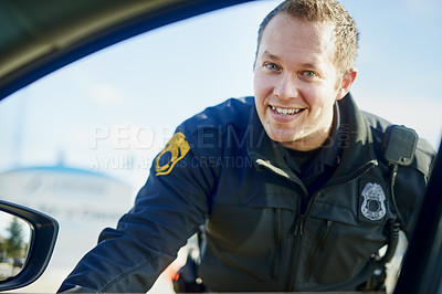 Buy stock photo Cropped portrait of a handsome young male traffic officer working at a roadblock