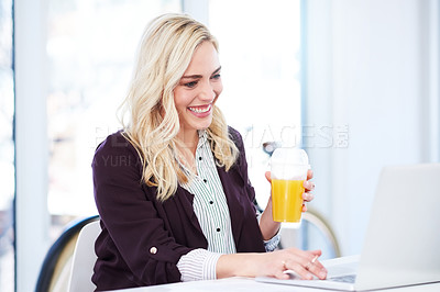 Buy stock photo Cropped shot of an attractive young businesswoman drinking orange juice while working in her office