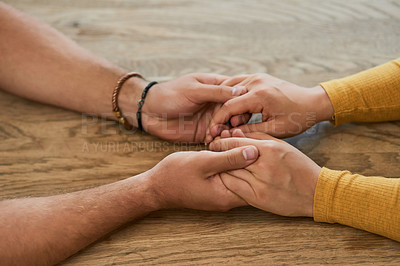 Buy stock photo Closeup shot of an unrecognizable couple holding hands at home