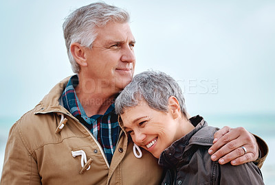 Buy stock photo Cropped shot of an affectionate senior couple standing outside