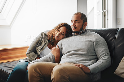 Buy stock photo Cropped shot of a young affectionate couple chilling on the couch in the living room at home
