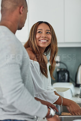 Buy stock photo Cropped shot of a young attractive couple washing their hands together in kitchen sink at home