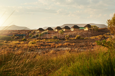 Buy stock photo Shot of a group of cottages situated inside of a luxurious holiday resort during the day