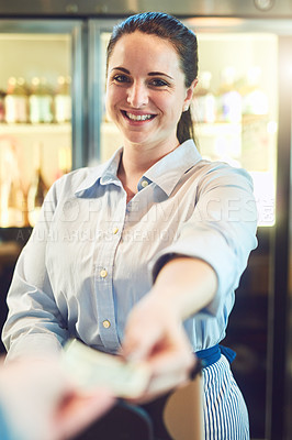 Buy stock photo Portrait of a young woman receiving payment from a customer in a cafe