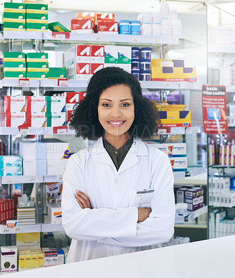Buy stock photo Cropped portrait of an attractive young female pharmacist working in a pharmacy