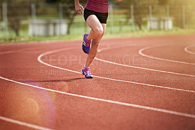 Buy stock photo Cropped of an unrecognizable athlete out running on the track