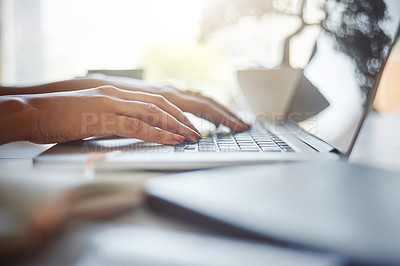 Buy stock photo Closeup shot of an unrecognizable female designer using a laptop in the office