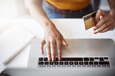 Buy stock photo High angle shot of an unrecognizable female designer shopping online in her home office