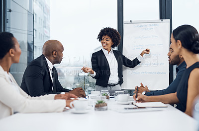 Buy stock photo Shot of a young businesswoman delivering a presentation to her colleagues in the boardroom of a modern office