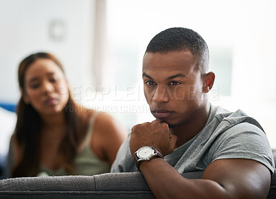 Buy stock photo Cropped shot of a young man giving his girlfriend the silent treatment after a fight