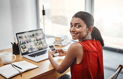 Buy stock photo Cropped shot of a young beautiful businesswoman using a cellphone in her home office