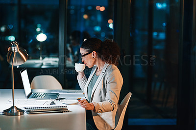 Buy stock photo Cropped shot of a young attractive businesswoman working late at the office