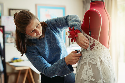 Buy stock photo Shot of a young fashion designer working on a new design