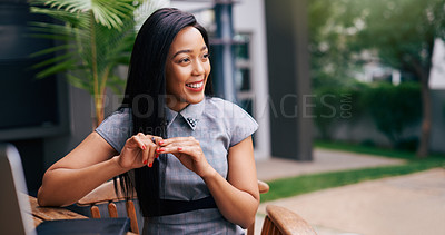 Buy stock photo Shot of an ambitious young businesswoman working outdoors