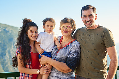 Buy stock photo Cropped portrait of an affectionate family of four standing outside