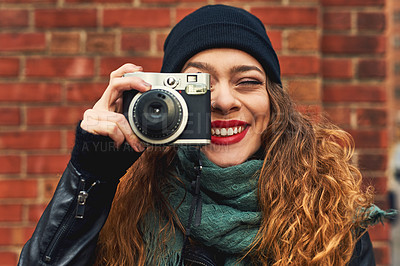 Buy stock photo Cropped shot of a young woman out in the city with her camera