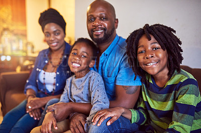 Buy stock photo Shot of a family of four spending the day at home