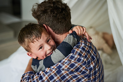Buy stock photo High angle portrait of an adorable little boy embracing his dad in his bedroom at home