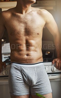 Buy stock photo Cropped shot of an unrecignizable shirtless man in the kitchen at home