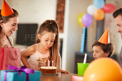 Buy stock photo Cropped shot of a family celebrating a birthday at home
