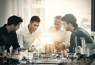 Buy stock photo Cropped shot of a group of businessmen having a meeting around a table in an office superimposed over a city background