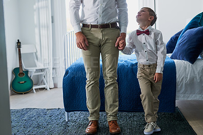 Buy stock photo Cropped shot of an adorable little boy and his unrecognizable father dressed in matching outfits