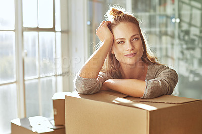 Buy stock photo Shot of a young woman moving into her new home