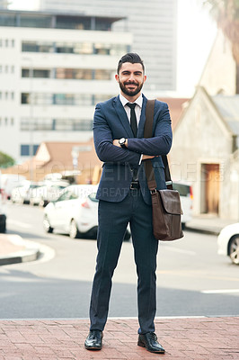 Buy stock photo Portrait of a handsome young businessman in the city
