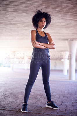 Buy stock photo Full length portrait of an attractive and athletic young woman standing outside with her arms folded