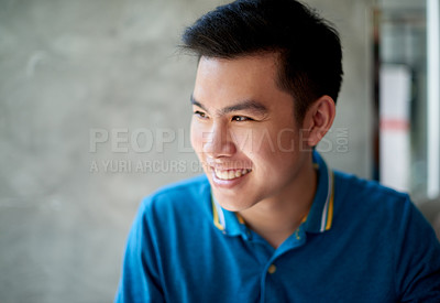 Buy stock photo Shot of a confident young man working on his laptop while looking outside through a window and contemplating inside a cafe during the day