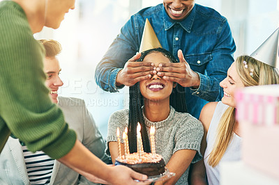 Buy stock photo Cropped shot of a young group of friends celebrating at a surprise birthday party together