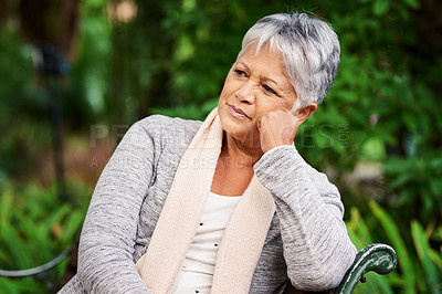 Buy stock photo Shot of a mature woman looking thoughtful outdoors