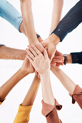 Buy stock photo Low angle shot of a group of unrecognizable creative businesspeople standing with their hands in a huddle in their office